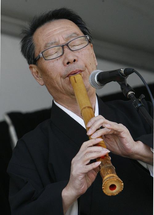 Scott Sommerdorf  |  The Salt Lake Tribune              Seizaburo Kubo, plays the shakuhachi and shinobue (Japanese flutes) at the Nihom Matsuri Japan Festival, Saturday, April 28, 2012.