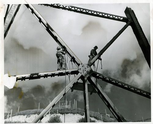 "Tribune file photo  The original caption on this 1939 photo says: ""Ed Ruben, left, and Ben Conklin, riveters, hoist platforms up to steel star in preparation for work."""