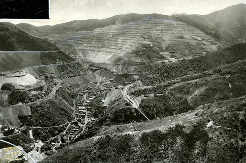 "Tribune file photo  The original caption on this 1942 photo says: ""A panoramic view of the Utah Copper Company's open cut mine in Utah, the largest in the world, and showing the town of Bingham with its single street--known as the narrowest city in the world."""