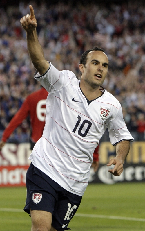 In this April 1, 2009, file photo, United States midfielder Landon Donovan celebrates after assisting on a goal by Jozy Altidore against Trinidad and Tobago during  the first half of a World Cup qualifying soccer match in Nashville, Tenn. (AP Photo/Mark Humphrey, File) ** You can find the entire  World Cup collection on apimages.com **