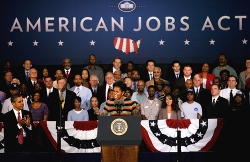 FILE- In this Wednesday, Oct. 19, 2011,  file photo, First lady Michelle Obama promotes the American Jobs Act, while at a stop at Joint Base Langley-Eustis, in Hampton, Va. The JOBS Act allows companies to raise up to $1 million a year. (AP Photo/Jason Hirschfeld)