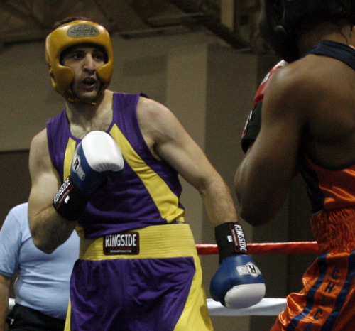 Boston bomb suspect Tamerlan Tsarnaev (in purple) fights Lamar Fenner (in orange) in this archive photo from the 201 weight class in the 2009 Golden Gloves National Boxing Tournament at the Salt Palace, Monday, May 4,  2009. Rick Egan/The Salt Lake Tribune