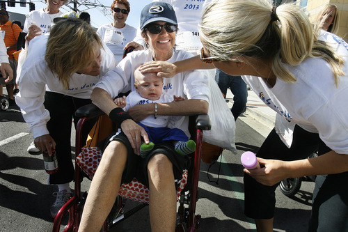 Scott Sommerdorf   |  The Salt Lake Tribune Leslie Swartwod, who has MS, did the walk in her wheelchair. Here she holds her grandson, Cohen, while surrounded by friends and family from Bountiful.  Thousands of people took part in the Salt Lake City MS Walk, Saturday, April 27, 2013.