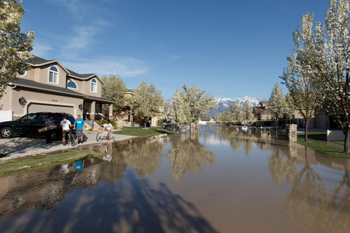 Trent Nelson  |  The Salt Lake Tribune A canal breach sent water flooding into a Murray neighborhood Saturday, April 27, 2013.