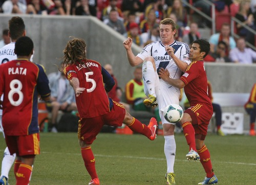 Kim Raff  |  The Salt Lake Tribune (left) Real Salt Lake midfielder Kyle Beckerman (5) and (right) Real Salt Lake defender Tony Beltran (2) put pressure on (middle) Los Angeles Galaxy forward Jack McBean (32) during the first half at Rio Tinto in Sandy on April 27, 2013. Real Salt Lake lost the game 2-0.
