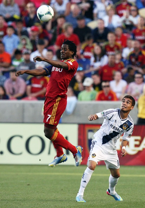 Kim Raff  |  The Salt Lake Tribune (left) Real Salt Lake defender Lovel Palmer (7) heads the ball over the head of (right) Los Angeles Galaxy midfielder Hector Jimenez (16) during the first half at Rio Tinto in Sandy on April 27, 2013. Real Salt Lake lost the game 2-0.