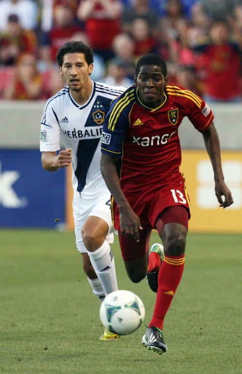 Kim Raff  |  The Salt Lake Tribune (front) Real Salt Lake forward Olmes Garcia (13) chases down the ball as Los Angeles Galaxy defender Omar Gonzalez (4) trails behind during the first half at Rio Tinto in Sandy on April 27, 2013. Real Salt Lake lost the game 2-0.