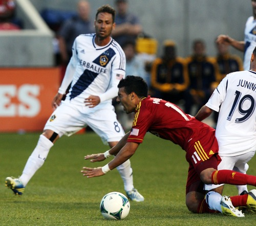 Kim Raff  |  The Salt Lake Tribune Real Salt Lake midfielder Javier Morales (11) reacts as he is tackled by (right) Los Angeles Galaxy midfielder Juninho (19) during the first half at Rio Tinto in Sandy on April 27, 2013. Real Salt Lake lost the game 2-0.