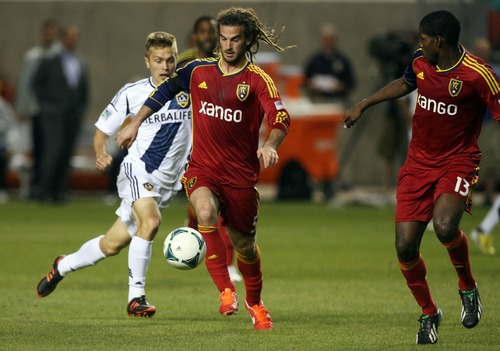 Kim Raff  |  The Salt Lake Tribune Real Salt Lake midfielder Kyle Beckerman (5) dribbles down the field during the second half against the Los Angeles Galaxy at Rio Tinto in Sandy on April 27, 2013. Real Salt Lake lost the game 2-0.