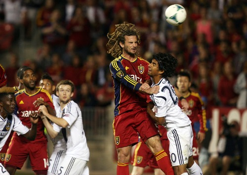 Kim Raff  |  The Salt Lake Tribune (left) Real Salt Lake midfielder Kyle Beckerman (5) and (right) Los Angeles Galaxy defender A.J. DeLaGarza (20) compete for a head ball in front of the Los Angeles Galaxy net late in the second half at Rio Tinto in Sandy on April 27, 2013. Real Salt Lake lost the game 2-0.