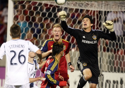 Kim Raff  |  The Salt Lake Tribune (middle) Real Salt Lake midfielder Sebastian Velasquez (26) can't get a head on the ball as (right) Los Angeles Galaxy goalkeeper Brian Rowe punches the ball in the air during the second half at Rio Tinto in Sandy on April 27, 2013. Real Salt Lake lost the game 2-0.