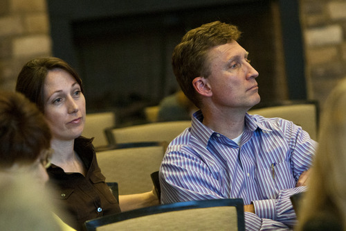 Chris Detrick  |  The Salt Lake Tribune Residents Allexis and Jeff Owen listen during a community meeting to discuss the annual balloon festival at the Pineview Lodge in Eden Thursday April 18, 2013.