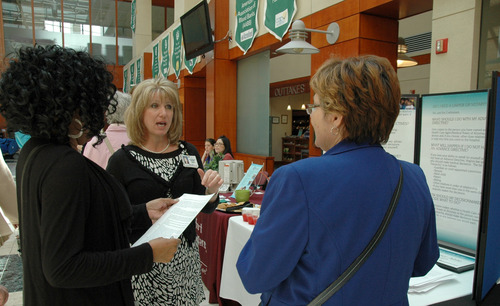 (AP Photo/Mary Washington Healthcare) Andrea Vassel of Mary Washington Healthcare explains the benefits of an advance directive at Mary Washington Hospital in Fredericksburg, Va., as part of National Healthcare Decisions Day earlier this month.