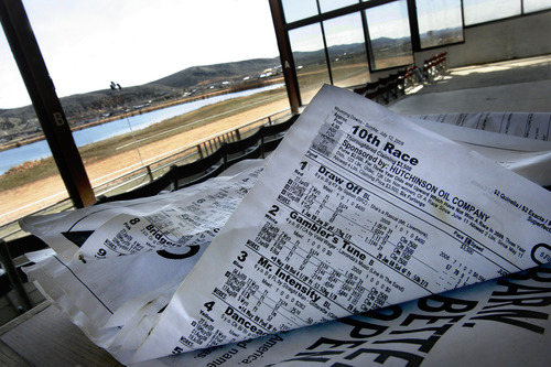 Scott Sommerdorf   |  The Salt Lake Tribune A long-abandoned racing form from july 12th of 2009 sits in the empty grandstand at Wyoming Downs, Thursday, April 25, 2013. The track has been dormant for 4-5 years, but brothers Eric and Paul Nelson are working to bring it back to life.