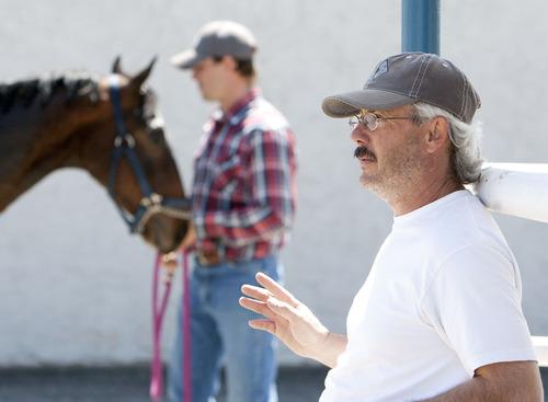 Steve Griffin | The Salt Lake Tribune   Chad Giles, of Stockton, Utah, with his horses at the Salt Lake Equestrian Park in South Jordan, Utah Friday April 26, 2013.  Tyler's Cartel will be racing at the park April 27, 2012.