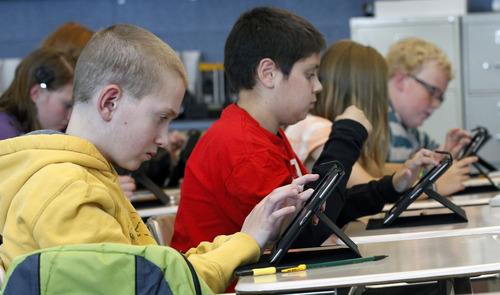 Al Hartmann  |  The Salt Lake Tribune North Davis Junior High School seventh-graders work out a math problem on their iPads.
