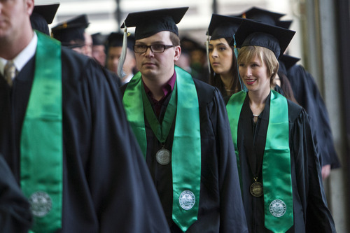 Chris Detrick  |  The Salt Lake Tribune Utah Valley University students walk to the Commencement exercises at the UCCU Events Center Thursday April 25, 2013.