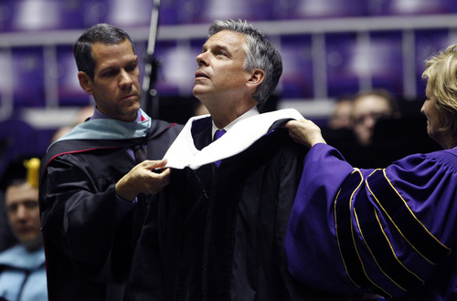 Al Hartmann  |  The Salt Lake Tribune Former Utah Gov. Jon Huntsman recieves an honorary degree from Weber State University Board of Trustees onFriday during graduation ceremonies. He later addressed the new graduates.