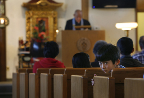 Scott Sommerdorf   |  The Salt Lake Tribune A young boy looks around during services at the Salt Lake Buddhist Temple, Sunday, April 21, 2013.