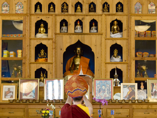Kim Raff  |  The Salt Lake Tribune Chopon Jared Kee stands in front of the shrine during a ceremony at the Urgyen Samten Ling Buddhist temple in Salt Lake City on April 21, 2013. The building was once a Mormon ward and a gothic nightclub before it was renovated and became a Buddhist temple.