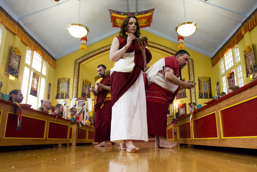 Kim Raff  |  The Salt Lake Tribune Members of the Urgyen Samten Ling Buddhist temple practice rituals during a ceremony in the temple in Salt Lake City on April 21, 2013. The building was once a Mormon ward and a gothic nightclub before it was renovated and became a Buddhist temple.
