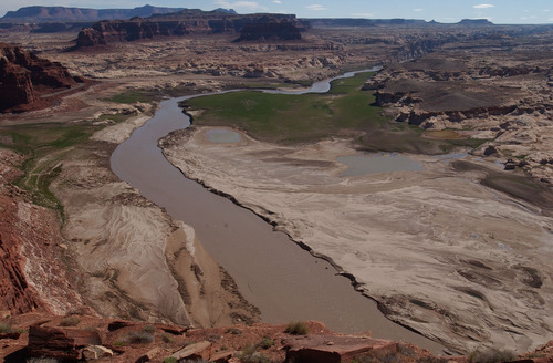 Trent Nelson | Tribune file photo A view from Hite Overlook at Lake Powell, showing low water levels in 2003 as the Colorado River runs through large deposits of sediment.