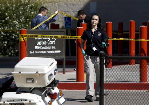 Kim Raff  |  The Salt Lake Tribune West Valley City Police investigate a shooting in and around the West Valley City Police Department in West Valley City on April 29, 2013. No police were injured and James Ramsey Kammeyer was taken into custody.