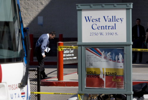 Kim Raff  |  The Salt Lake Tribune West Valley City Police investigate a shooting in and around the West Valley City Police Department and West Valley  Central TRAX platform in West Valley City on April 29, 2013. No police were injured and James Ramsey Kammeyer was taken into custody.