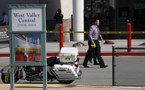 Francisco Kjolseth  |  The Salt Lake Tribune Police investigate the scene of a shooting Monday at the West Valley City Police Department lobby, next to the West Valley Central TRAX stop.