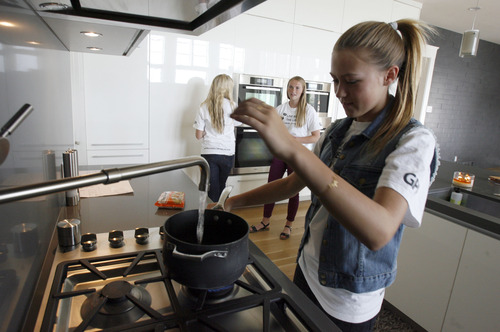 "Francisco Kjolseth  |  The Salt Lake Tribune Sydney Pedersen, 15, a Canyon View Junior High student in Orem cooks up a package of ramen noodles to eat later for dinner as she participates with friends in the ""Live Below the Line"" campaign that is part of the Global Poverty Project. It raises awareness about how challenging it is for people in poverty to eat and drink on just $1.50 per day. Pedersen, who has raised $36,000 in the past two weeks, hopes to raise a total of $100,000 as she and her family and friends live on the limited food budget for five days."
