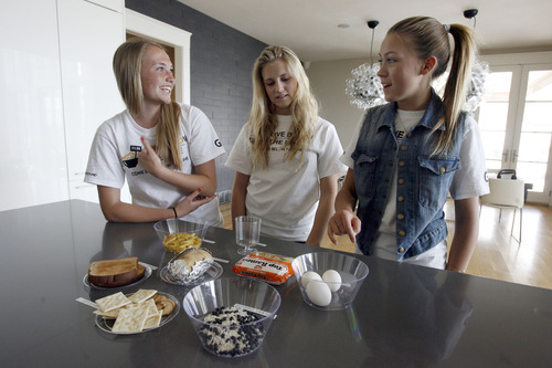 "Francisco Kjolseth  |  The Salt Lake Tribune Sydney Pedersen, 15, far right, a Canyon View Junior High student in Orem, talks about how hungry she already is with friends Kristen Woolley, 15, left, and Mallory Madsen, 14, as they participate in the ""Live Below the Line"" campaign. It is part of the Global Poverty Project and raises awareness about how challenging it is for people in poverty to eat and drink on just $1.50 per day. Pedersen, who has raised $36,000 in the past two weeks, hopes to raise a total of $100,000 as she and her family and friends try to live on so little for five days."