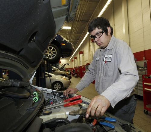 Al Hartmann  |  The Salt Lake Tribune Service technician Hector Zapata works on a hybrid engine at Mark Miller Toyota service department Monday April  29.  AAA issued its annual cost of driving report, which showed it costs the average sedan owner $9,122 to own and operate the vehicle. AAA has studied insurance, fuel, maintenance and other variables since 1950. This year shows an 11 percent increase in maintenance costs.