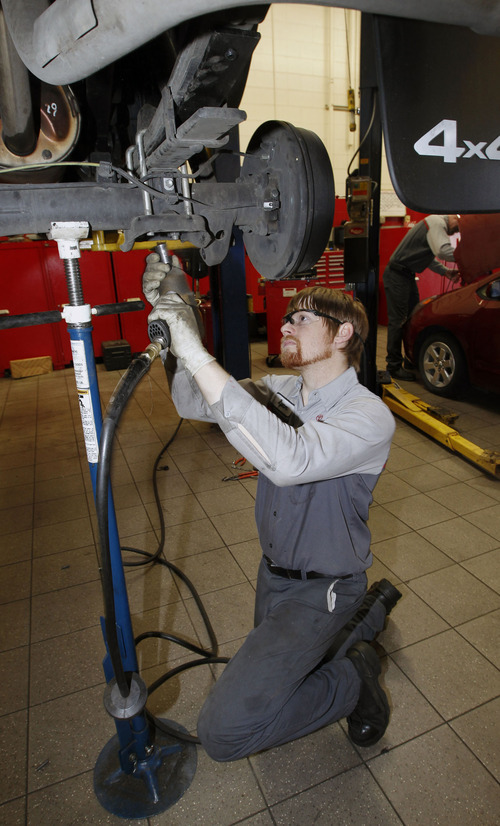 Al Hartmann  |  The Salt Lake Tribune Service technician Ryan Dawson works on the rear suspension of a four-wheel-drive truck at Mark Miller Toyota service department Monday April  29.  AAA issued its annual cost of driving report, which showed it costs the average sedan owner $9,122 to own and operate the vehicle. AAA has studied insurance, fuel, maintenance and other variables since 1950. This year shows an 11 percent increase in maintenance costs.