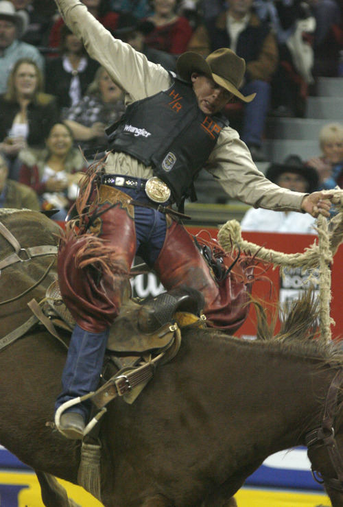 Rick Egan  | The Salt Lake Tribune   Cody Wright, Milford, rides in the barrel racing competition, at the National Finals Rodeo, in Las Vegas, Thursday, December 8, 2011.