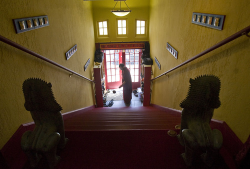 Kim Raff     The Salt Lake Tribune Chopon Jared Kee walks with incense around the front entrance during a ceremony in the Urgyen Samten Ling Buddhist temple in Salt Lake City on April 21, 2013. The building was once a Mormon ward and a gothic nightclub before it was renovated and became a Buddhist temple.