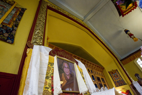 Kim Raff  |  The Salt Lake Tribune A picture of the Dalai Lama is displayed on the shrine of the Urgyen Samten Ling Buddhist temple in Salt Lake City on April 21, 2013. The molding around the arch was kept intact since it's original construction. The building has had diverse occupants and was once a Mormon ward and a gothic nightclub before it was renovated and became a Buddhist temple.