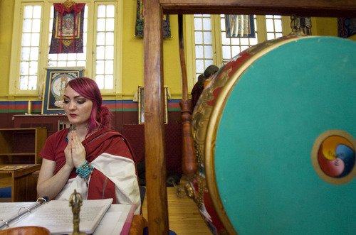 Kim Raff  |  The Salt Lake Tribune Andrea Hansen participates in a ceremony at the Urgyen Samten Ling Buddhist temple in Salt Lake City on April 21, 2013. The building was once a Mormon ward and a gothic nightclub before it was renovated and became a Buddhist temple.