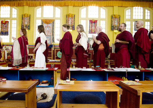 Kim Raff  |  The Salt Lake Tribune Member of the Urgyen Samten Ling Buddhist temple perform rituals during a ceremony in Salt Lake City on April 21, 2013. The building was once a Mormon ward and a gothic nightclub before it was renovated and became a Buddhist temple.