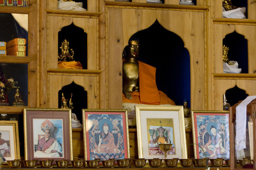 Kim Raff  |  The Salt Lake Tribune Images and statues adorn the shrine at the Urgyen Samten Ling Buddhist temple in Salt Lake City on April 21, 2013. The building was once a Mormon ward and a gothic nightclub before it was renovated and became a Buddhist temple.