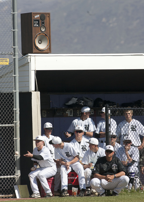 Steve Griffin | The Salt Lake Tribune  A speaker, above the Riverton dugout,  blasts music between innings during game against Lone Peak at Riverton High School in Riverton, Utah Friday April 26, 2013.