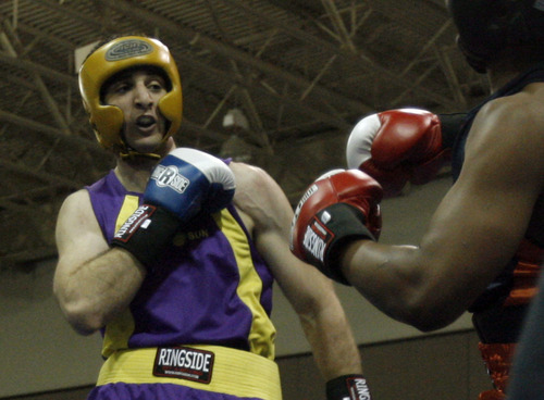 Rick Egan | The Salt Lake Tribune Boston bomb suspect Tamerlan Tsarnaev (in purple) fights Lamar Fenner (in orange) in this archive photo from the 201 weight class in the 2009 Golden Gloves National Boxing Tournament at the Salt Palace, Monday, May 4,  2009.