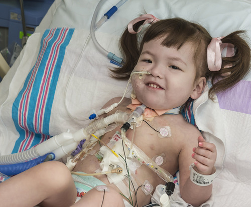 In this April 26, 2013 photo provided by OSF Saint Francis Medical Center in Peoria, Ill., Hannah Warren, 2, lies in bed in a post-op room at the Children's Hospital of Illinois in Peoria, after having received a new windpipe in a landmark transplant operation on April 9, 2013. Hannah was born in South Korea without a windpipe but received a new one made from her own stem cells. She is the youngest patient ever to get the experimental treatment. Doctors announced Tuesday, April 30, 2013 she is recovering and likely will lead a normal life. (AP Photo/OSF Saint Francis Medical Center, Jim Carlson)