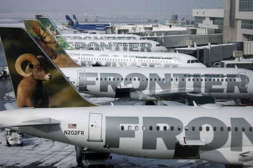 Frontier Airlines is adding a fee for carry-on bags, and plans to start charging $2 for soda and coffee.  (AP Photo/David Zalubowski, File)