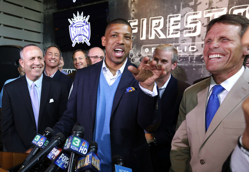 Sacramento Mayor Kevin Johnson, center, jokes with a reporter at a news conference, Monday, April 29, 2013, in Sacramento, Calif. The NBA's relocation committee voted unanimously Monday to recommend that owners reject the application for the Sacramento Kings basketball team to relocate to Seattle, the latest -- and by far the strongest -- in a long line of cities that almost landed the franchise. (AP Photo/Rich Pedroncelli)