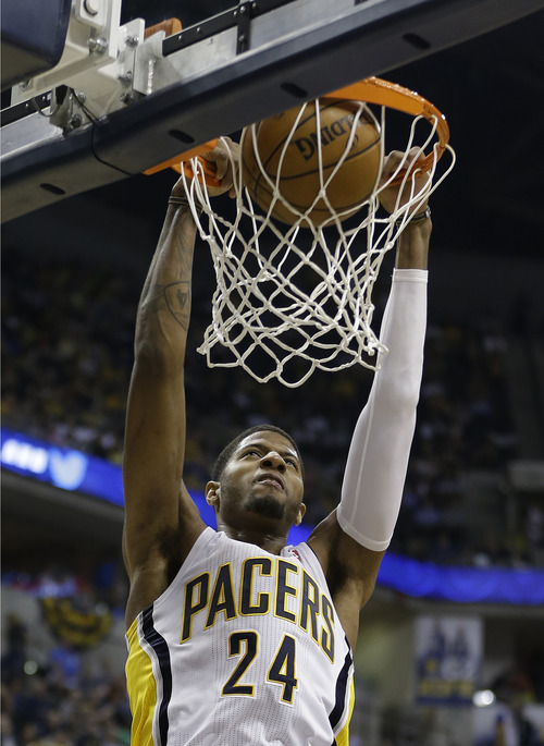 Indiana Pacers' Paul George (24) dunks during the second half of Game 5 in the first round of the NBA basketball playoff series against the Atlanta Hawks, Wednesday, May 1, 2013, in Indianapolis.  (AP Photo/Darron Cummings)