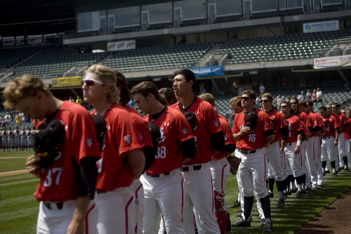 Kim Raff  |  The Salt Lake Tribune University of Utah baseball players line up on the field during the national anthem before a game against PAC-12 competitor Arizona State at Spring Mobile Ballpark in Salt Lake City on April 28, 2013. The University of Utah baseball team is competitive in the PAC-12 and is using many local players.