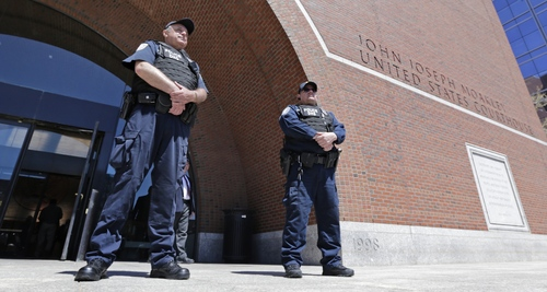 Department of Homeland Security police officers stand watch outside the Moakley Federal Courthouse in Boston, Mass., Wednesday, May 1, 2013.  Three suspects were taken into custody in the Boston Marathon bombing case including two college friends of Dzhokhar Tsarneav, according to officials.  (AP Photo/Charles Krupa)