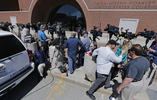 Television cameramen wait outside the Moakley Federal Courthouse in Boston, Mass., Wednesday, May 1, 2013.  Three suspects were taken into custody in the Boston Marathon bombing case including two college friends of Dzhokhar Tsarneav, according to officials.  (AP Photo/Charles Krupa)