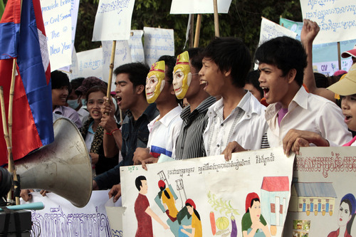Cambodian garment factory workers stage a rally to mark the May Day in Phnom Penh, Cambodia, Wednesday, May 1, 2013. The rally participants called the government for a raise in their minimum wages and better working condition. (AP Photo/Heng Sinith)