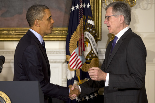 President Barack Obama shakes hands with his nominee for Federal Housing Finance Authority (FHFA), Tom Wheeler, in the State Dining Room of the White House in Washington, Wednesday, May 1, 2013, after the president made the announcement.  (AP Photo/Jacquelyn Martin)